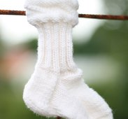 A baby sock from sliding down